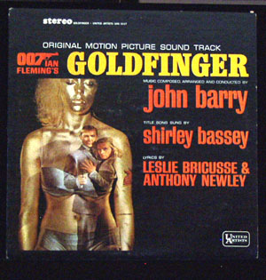 Pictured is a soundtrack long-playing vinyl record for the 1964 Guy Hamilton film Goldfinger starring Sean Connery, featuring the title song performance by Shirley Bassey, with music composed, arranged and conducted by John Barry.