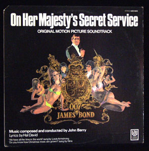Pictured is a soundtrack long-playing vinyl record for the 1969 Peter R. Hunt film On Her Majesty's Secret Service starring George Lazenby, featuring the song We Have All the Time in the World performed by Louis Armstrong.